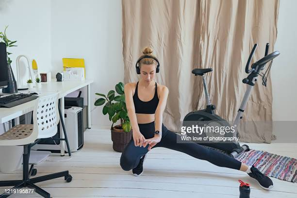 young adult woman exercising at home, stay at home covid-19 quarantine gym, healthy lifestyle, bodyweight exercises - real body fotografías e imágenes de stock