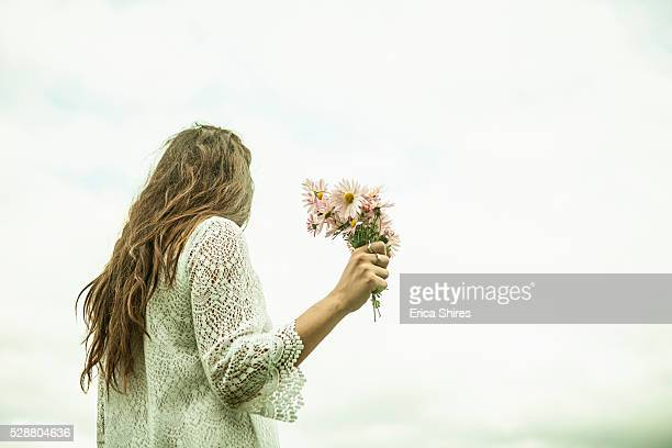 Young adult woman holding bouquet