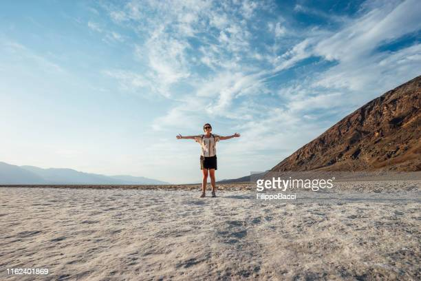 young adult woman in badwater basin, death valley - great basin stock pictures, royalty-free photos & images