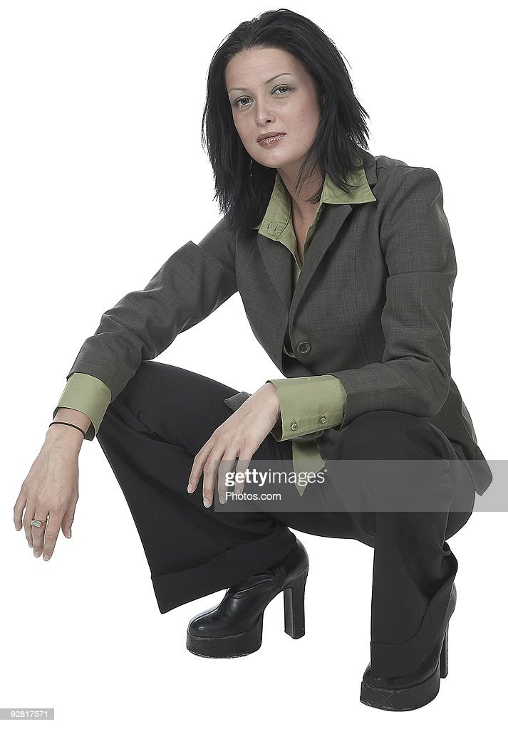 Young Adult Woman In Crouching Pose High Res Stock Photo Getty Images
