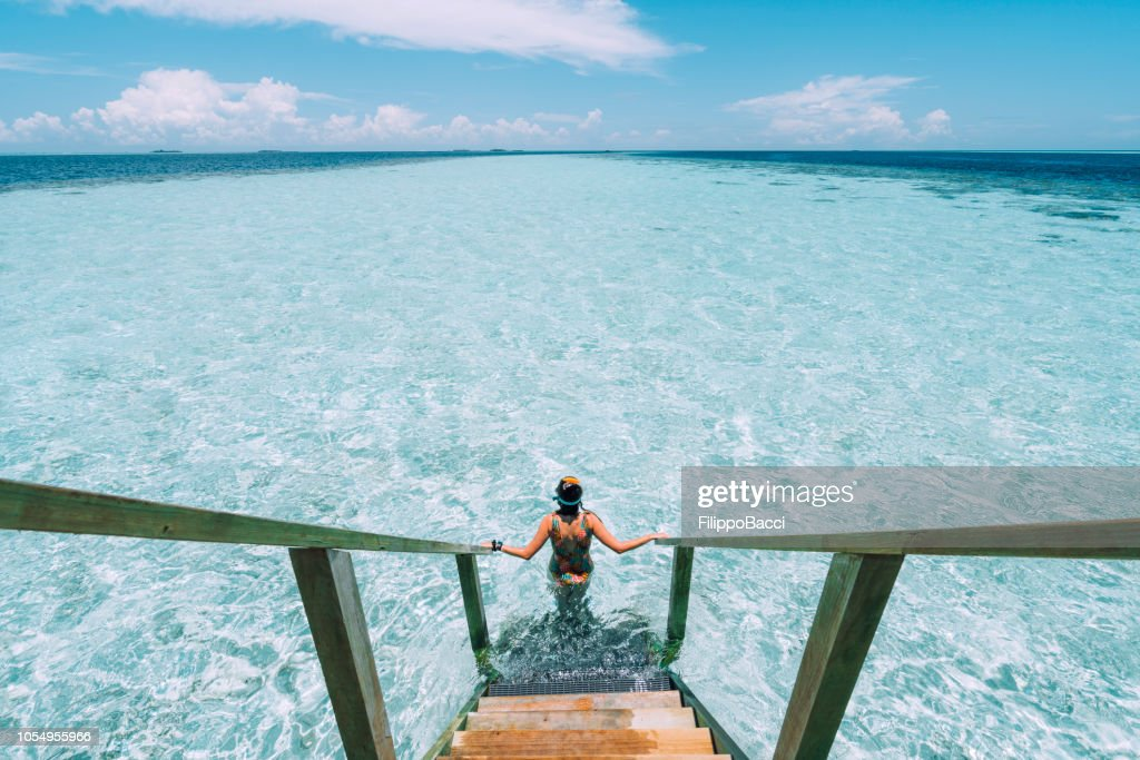 Young adult woman moving down to the sea : Stock Photo