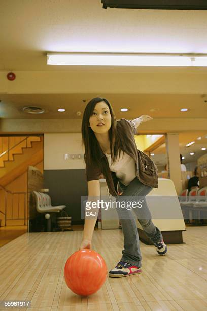 Young Adult Woman Playing Bowling