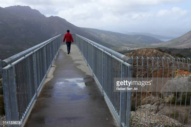 Young adult woman travelling at the West Coast Range of Tasmania Australia