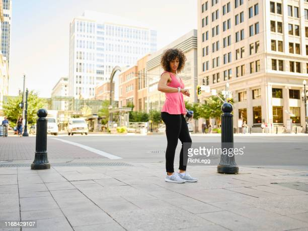 young adult woman walking on a break - rich_legg stock pictures, royalty-free photos & images