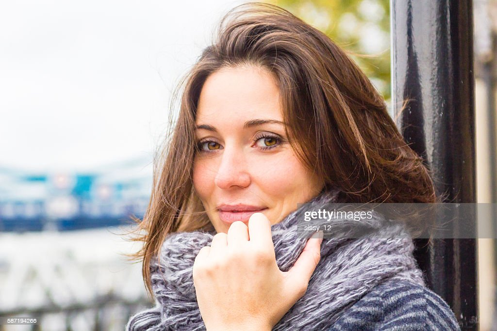 Young Adult woman with scarf in autumn London : Stock Photo