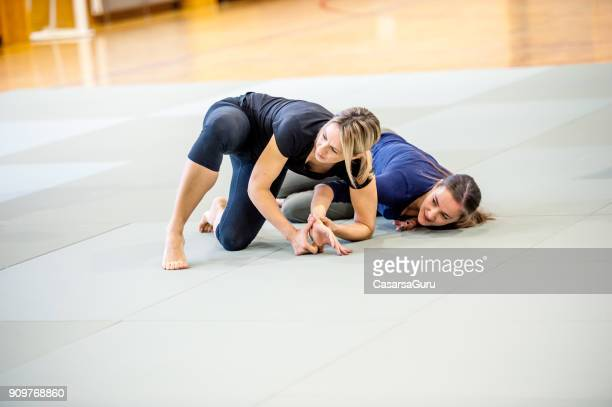 Young Adult Women at Selfdefence Course with Judo Trainer