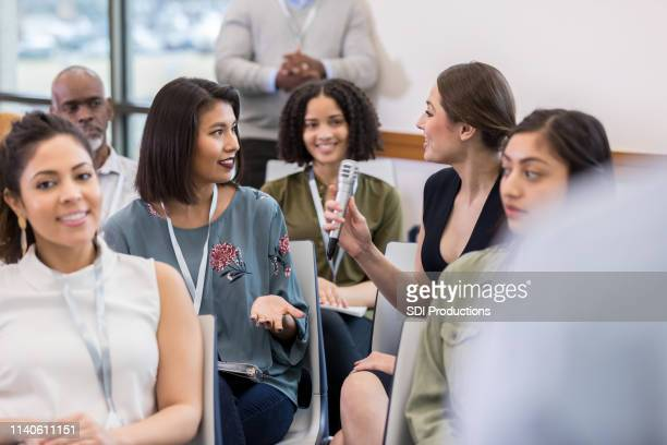 young adult women discuss a proposal - attending stock pictures, royalty-free photos & images