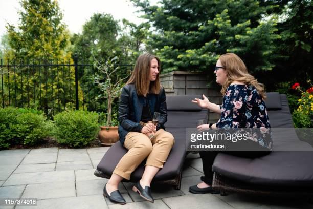"young adult women in heartfelt conversation outdoor in summer. - ""martine doucet"" or martinedoucet stock-fotos und bilder"