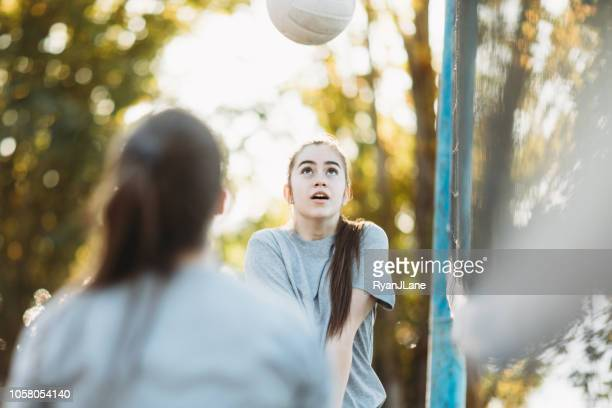 Young Adult Women Playing Outdoor Volleyball