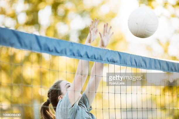 young adult women playing outdoor volleyball - beach volleyball stock pictures, royalty-free photos & images