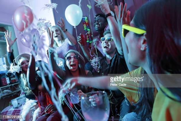 young adults at house party - party stock pictures, royalty-free photos & images