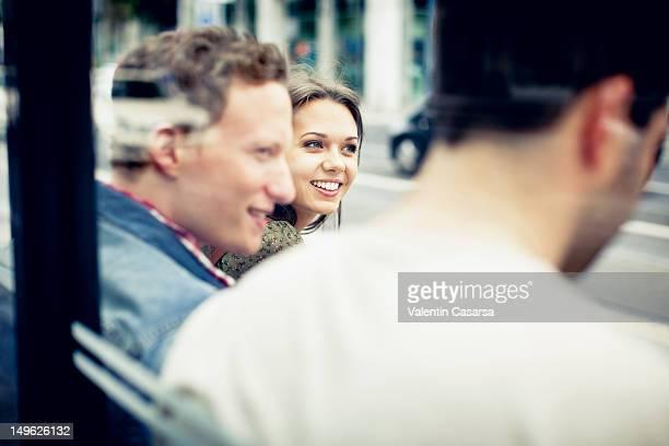 young adults at tram station - mise au point sélective photos et images de collection