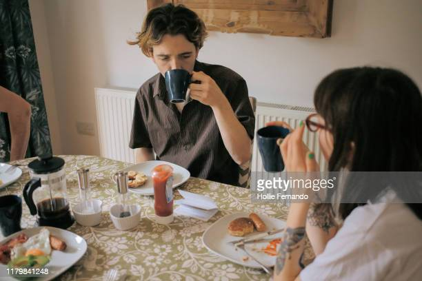 young adults breakfast at home - sunday stock pictures, royalty-free photos & images