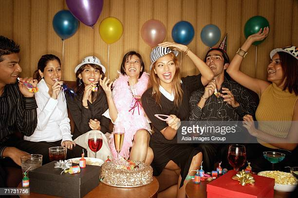young adults celebrating birthday - clubkleding stockfoto's en -beelden