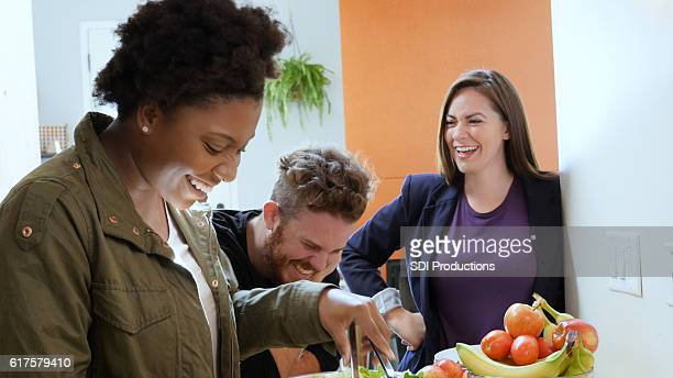 Young adults enjoy preparing meal together