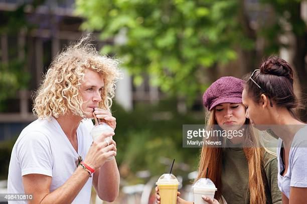 young adults enjoying smoothies