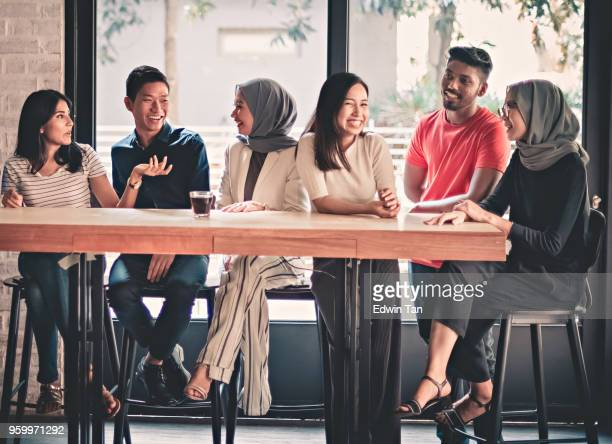 young adults friends gathering at cafe - malaysia stock pictures, royalty-free photos & images