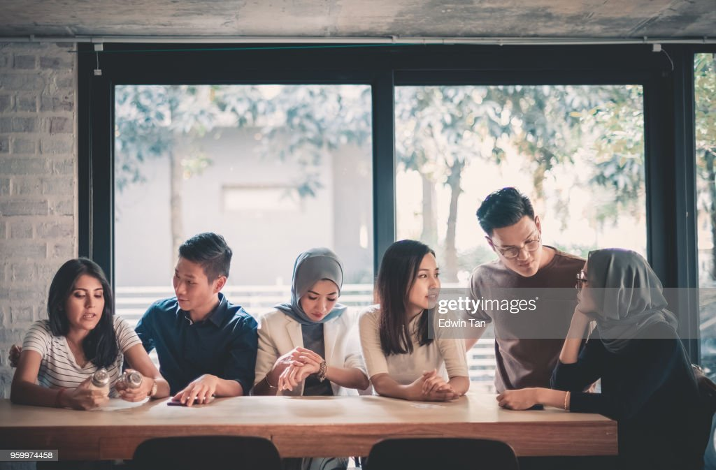 young adults friends gathering at cafe : Stock Photo