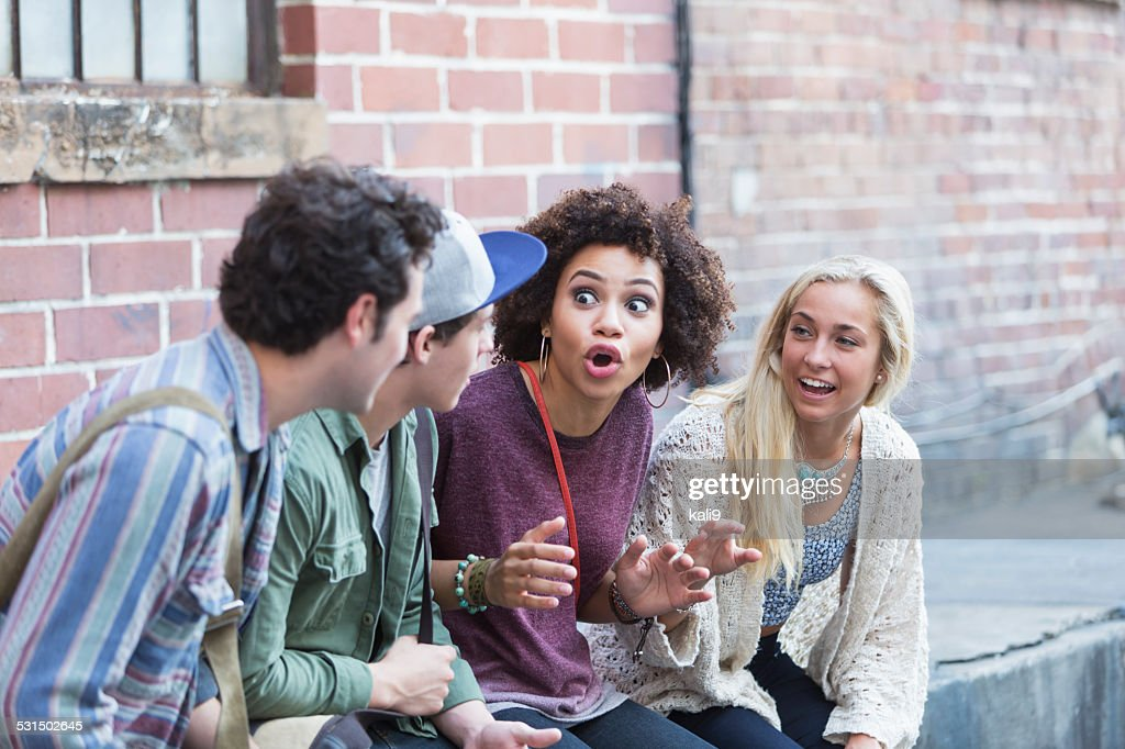 Young adults hanging out talking : Stock Photo