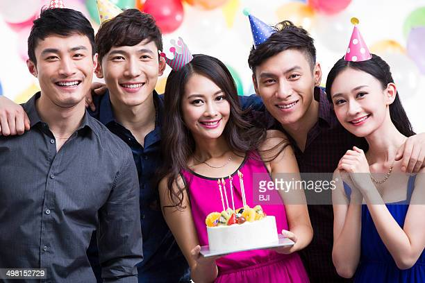 Young adults having a birthday party