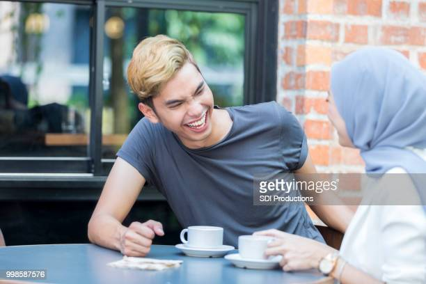 Young adults having tea in cafe