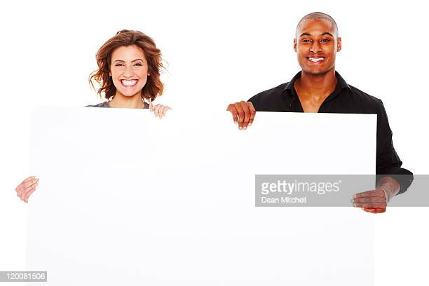 young adults holding blank sign - isolated - blank sign stock photos and pictures