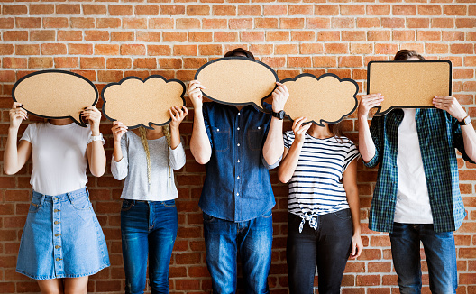 Young adults holding up copy-space placard thought bubbles 922726444