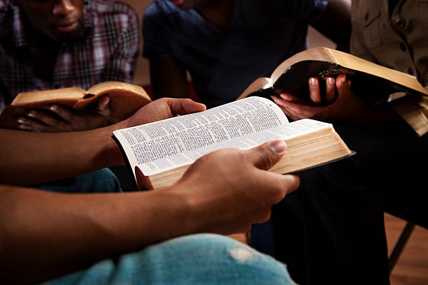 young adults in a bible study. - bible stock pictures, royalty-free photos & images