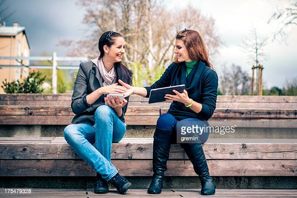 young adults online with digital tablets - stranger stock pictures, royalty-free photos & images