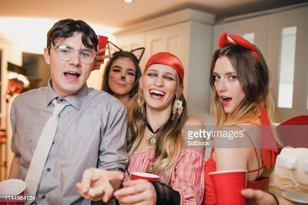 young adults partying - cat costume stock photos and pictures