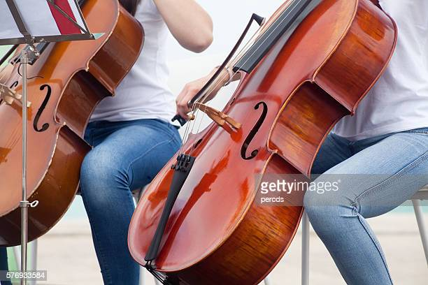 young adults playing cello - stringed instrument fotografías e imágenes de stock