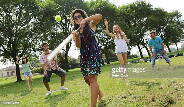 young adults playing cricket in park - wicket stock pictures, royalty-free photos & images