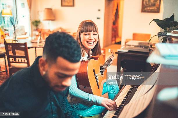 Young adults playing piano together