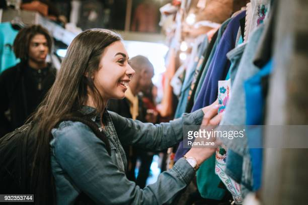 Young Adults Shop For Clothes at Thrift Store