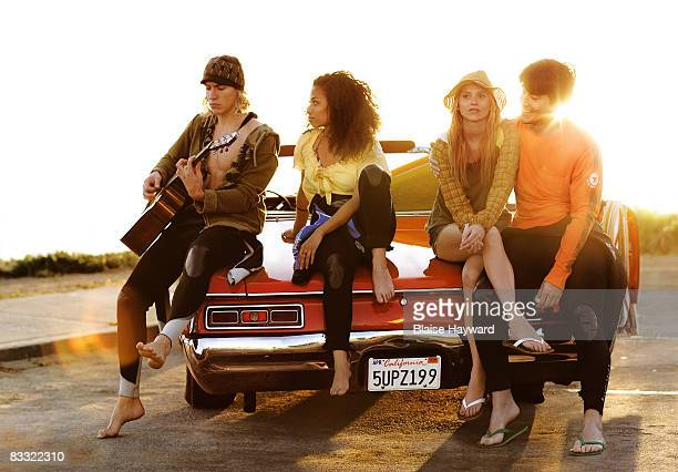 young adults sitting on a car - hayward california stock pictures, royalty-free photos & images