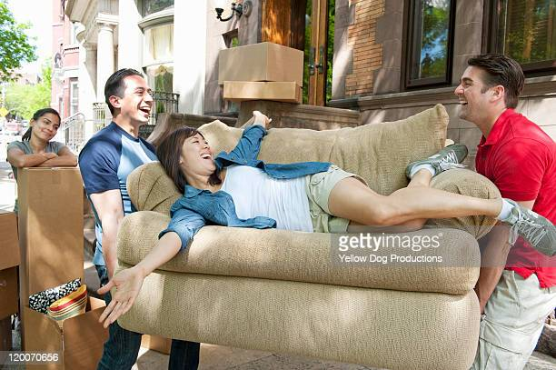 young adults taking a break while moving - naughty america stock pictures, royalty-free photos & images