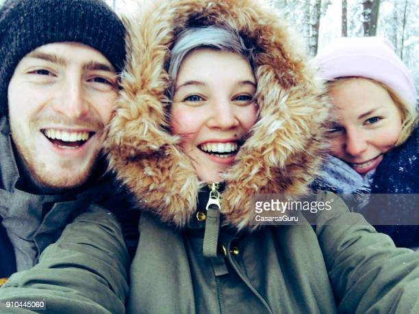 young adults taking a selfie in tempere, finland - finland stock pictures, royalty-free photos & images