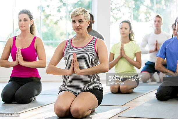 Young Adults Taking a Yoga Class