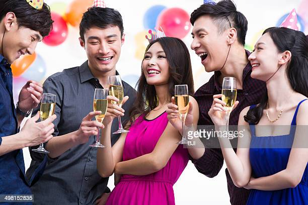 Young adults toasting in party