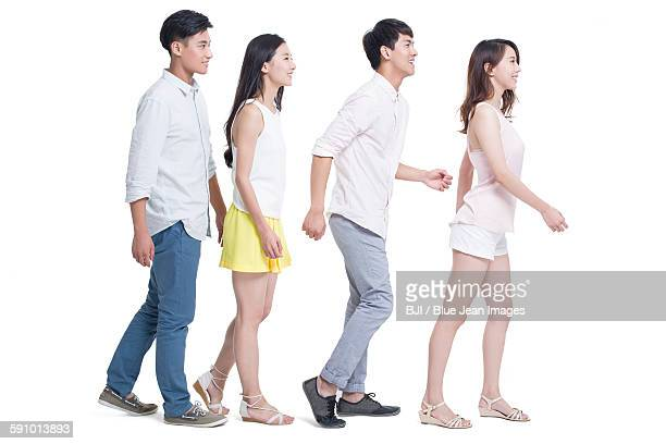 Young adults walking in a line