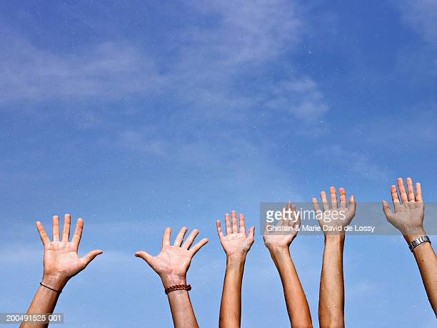 Young adults with arms raised, wet
