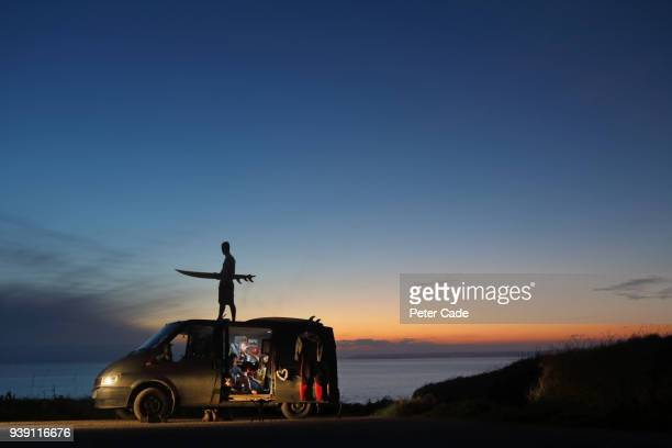 young adults with camper van at sunset - vehicle door stock pictures, royalty-free photos & images