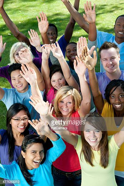 Young Adults with Hands Up
