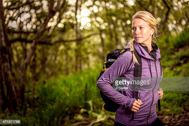 young adventurous woman surrounded by nature on a hiking trip - purple shirt stock photos and pictures