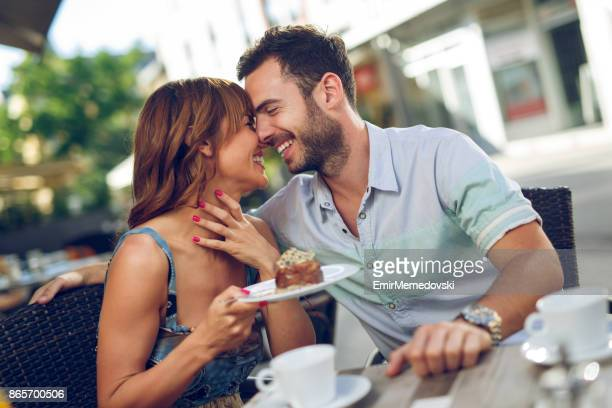 Young affectionate couple having a date in a cafe.