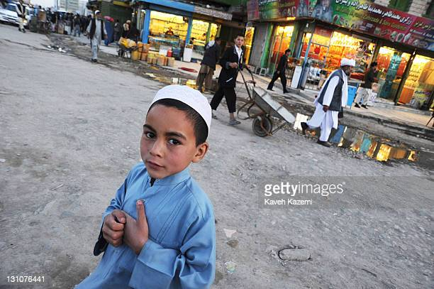 Young Afghan boy seen in Deh Afghanan market place on October 15, 2011 in Kabul, Afghanistan.