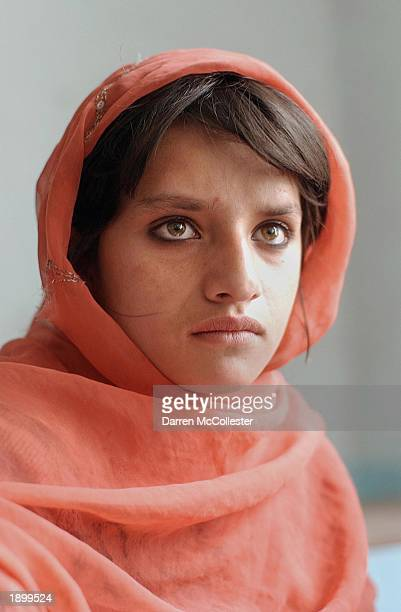A young Afghan girl listens during class April 5 2003 at the Aschiana School in Kabul Afghanistan The Aschiana School is a school designed for...