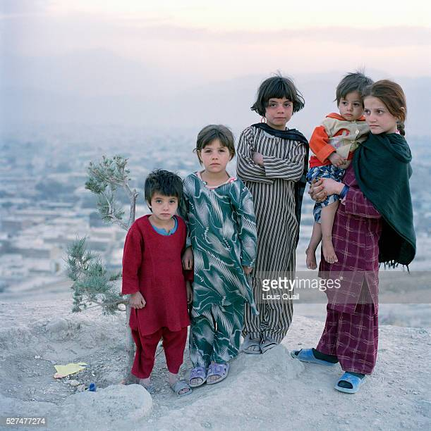 Young Afghan girls Historai Sheba Rifer Soloha and Tina 4 on a hilltop overlooking Nadir Shah and Kabul Children have been the primary victims of...