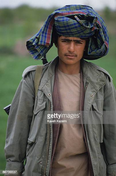 A young Afghan Mujahid stands guard on a rooftop on the outskirts of Herat Afghanistan 23rd April 1992