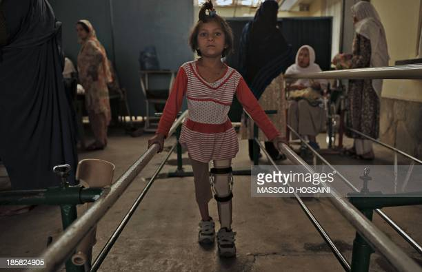 A young Afghan patient exercises with her artificial leg at one of the International Committee of the Red Cross hospitals for war victims and...
